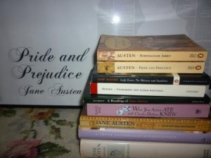 A selection of my Austen-related book collection...in front of my A0 sized full-text poster of 'Pride and Prejudice'. Obsessive? Me?
